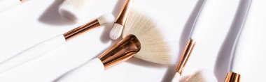 Close up view of cosmetic brushes set on white background, panoramic shot stock vector
