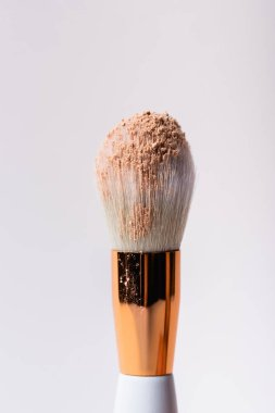 Close up view of cosmetic brush with face powder isolated on white stock vector
