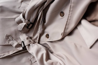 Close up of stylish and beige trench coat stock vector