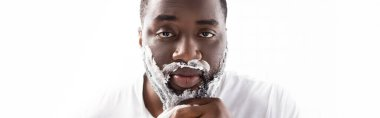Panoramic shot of afro-american man with shaving foam on face looking at camera stock vector