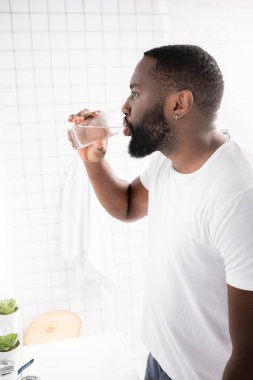 Side view of afro-american man drinking water stock vector