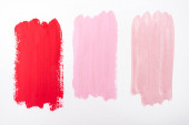 top view of abstract pink and red paint brushstrokes on white background