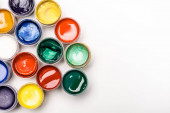 top view of colorful Gouache paints on white background
