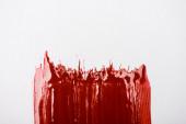 felső nézet színes piros festék ecsetvonás fehér háttér