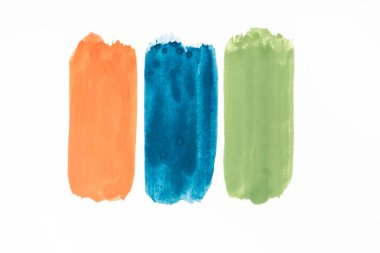 Top view of abstract colorful green, orange and blue paint brushstrokes on white background stock vector