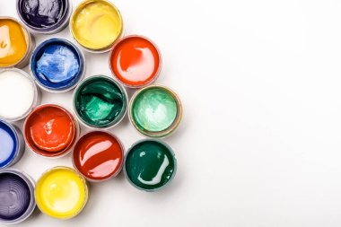 Top view of colorful Gouache paints on white background stock vector