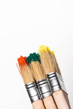 Top view of paintbrushes with colorful paint on white background stock vector