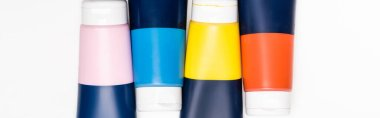 Top view of acrylic paint tubes on white background, panoramic shot stock vector