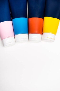 Top view of acrylic paint tubes on white background stock vector