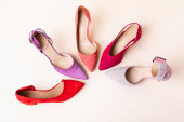 Photo top view of suede colorful heeled shoes on beige background