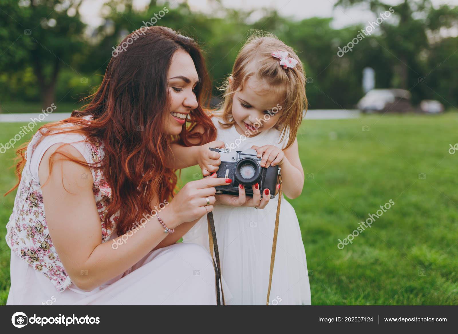 smiling woman light dress little cute child baby girl holding