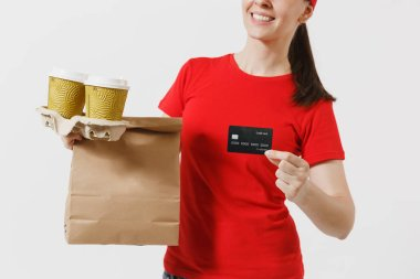 Woman in red cap, t-shirt giving fast food order isolated on white background. Female courier holding credit card, paper packet with food, coffee. Products delivery from shop or restaurant to home