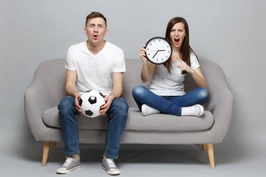 Shocked angry couple woman man football fans in white t-shirt ch