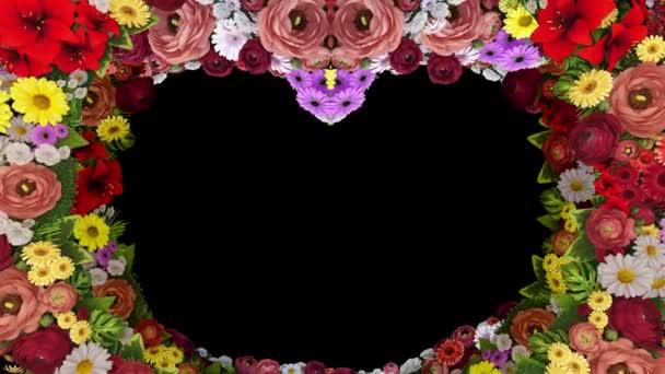 Animáció a kavargó virágok alkotó egy szív sziluett, a fekete háttér. Sablon Üdvözlet, esküvő, Valentin-nap, anyák napja, családi nap, születésnap. Hurok videóinak.