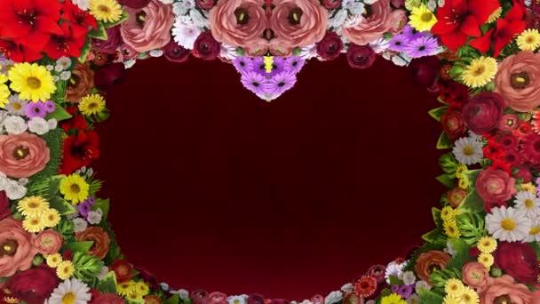 Animace z vířící květy tvoří silueta srdce na červeném pozadí slavnostní. Šablona pro pozdravy pro svatba, Valentýn, den matek, den rodiny, narozeniny. Loop video.