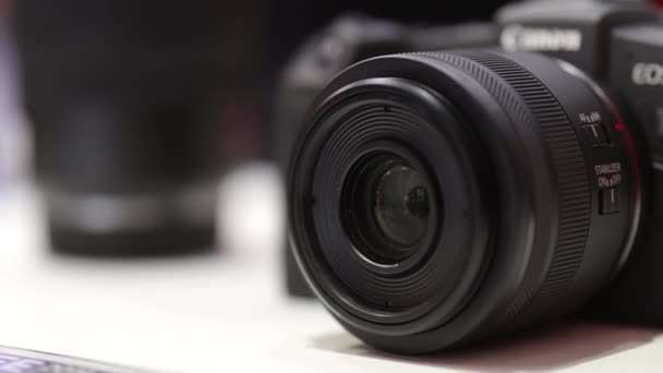Kyiv, Ukraine - April 7, 2019 New mirror less EOS R Canon camera with lens close-up.