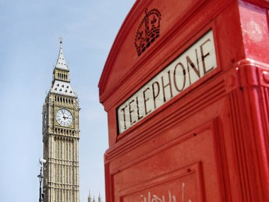 Bright vibrant iconic London scenes, red telephone box with Big Ben in background.