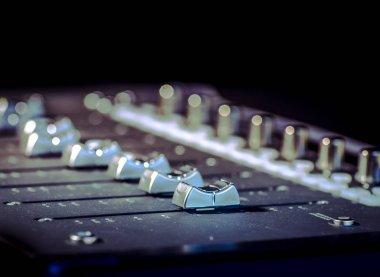Audio mixer soundboard at dark smoke filled event