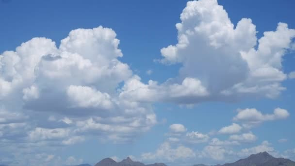 White fluffy Clouds forming over blue Arizona sky