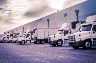 Trucks loading unloading at warehouse  shipping logistics transport concept image