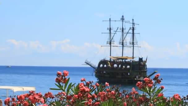 Flowers Oleander and pirate ship sail  in Kemer, Turkey