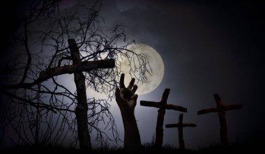 Halloween concept ofwooden cross on graveyard