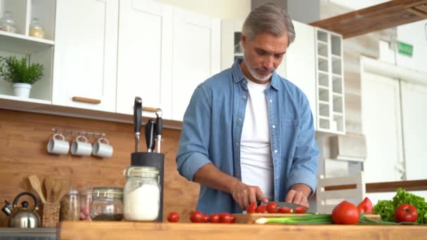 Happy man preparing romantic surprise, smiling husband cooking healthy food