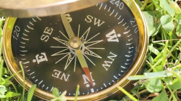 Compass on grass in closeup