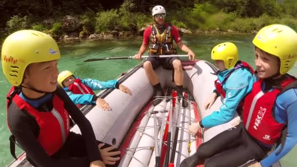 Adventure POV shot of family rafting on the Soca river in Slovenia.