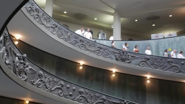 VATICAN, VATICAN CITY -  JULY 14 2018: People descending the modern Bramante spiral stairs of the Vatican Museums, designed by Giuseppe Momo in 1932