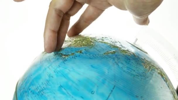 hand walking over earth globe , globetrotter concept on white background