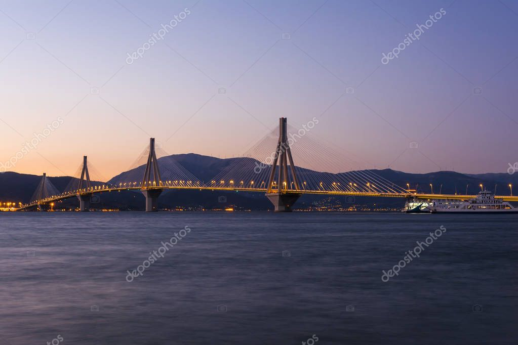 View of Rio-Antirio bridge at dusk, Greece. The Rio Antirrio Bridge is one of the world's longest multi-span cable-stayed bridges.