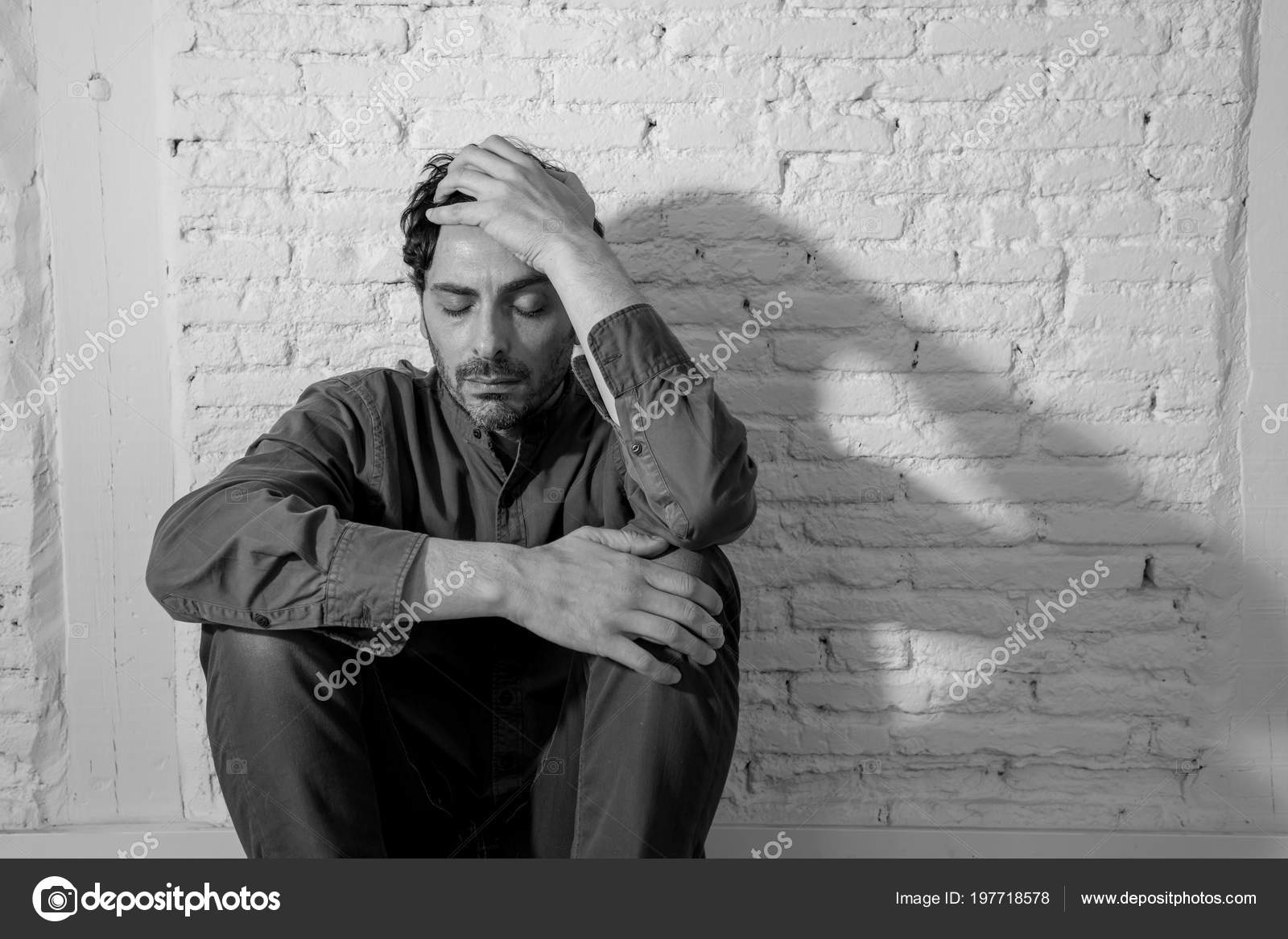 Young Depressed Man Sitting White Wall Home Shadow Wall Feeling Stock Photo Samwordley Gmail Com 197718578