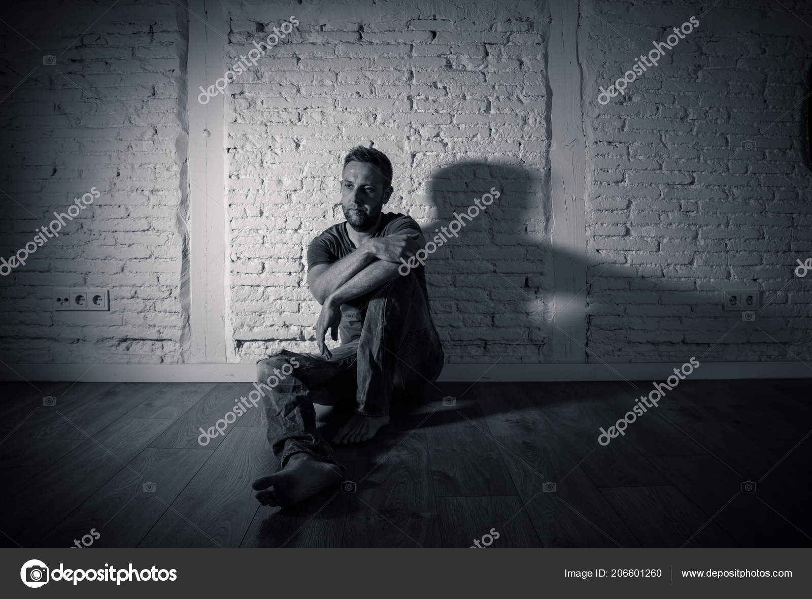 Lonely man suffering from depression stock photo