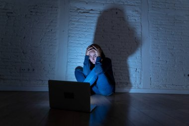 Woman suffering Internet cyber bullying