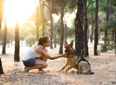 Woman teaching and loving her dog