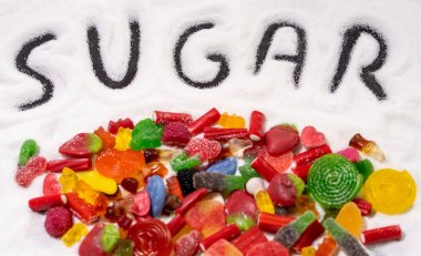 Mix of candies and written word sugar