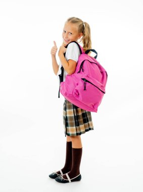 Pretty cute blonde hair girl with a pink schoolbag looking at camera showing thumb up gesture happy to go to school isolated on white background in back to school and children education concept