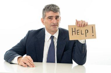 Helpless mature businessman holding a help sign in financial crisis unemployment stress and depression concept isolated in white background.