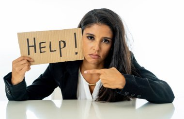 Young beautiful latin business woman overwhelmed and tired holding a help sign. looking Stressed, bored, frustrated, upset and unhappy at work. business frustration concept