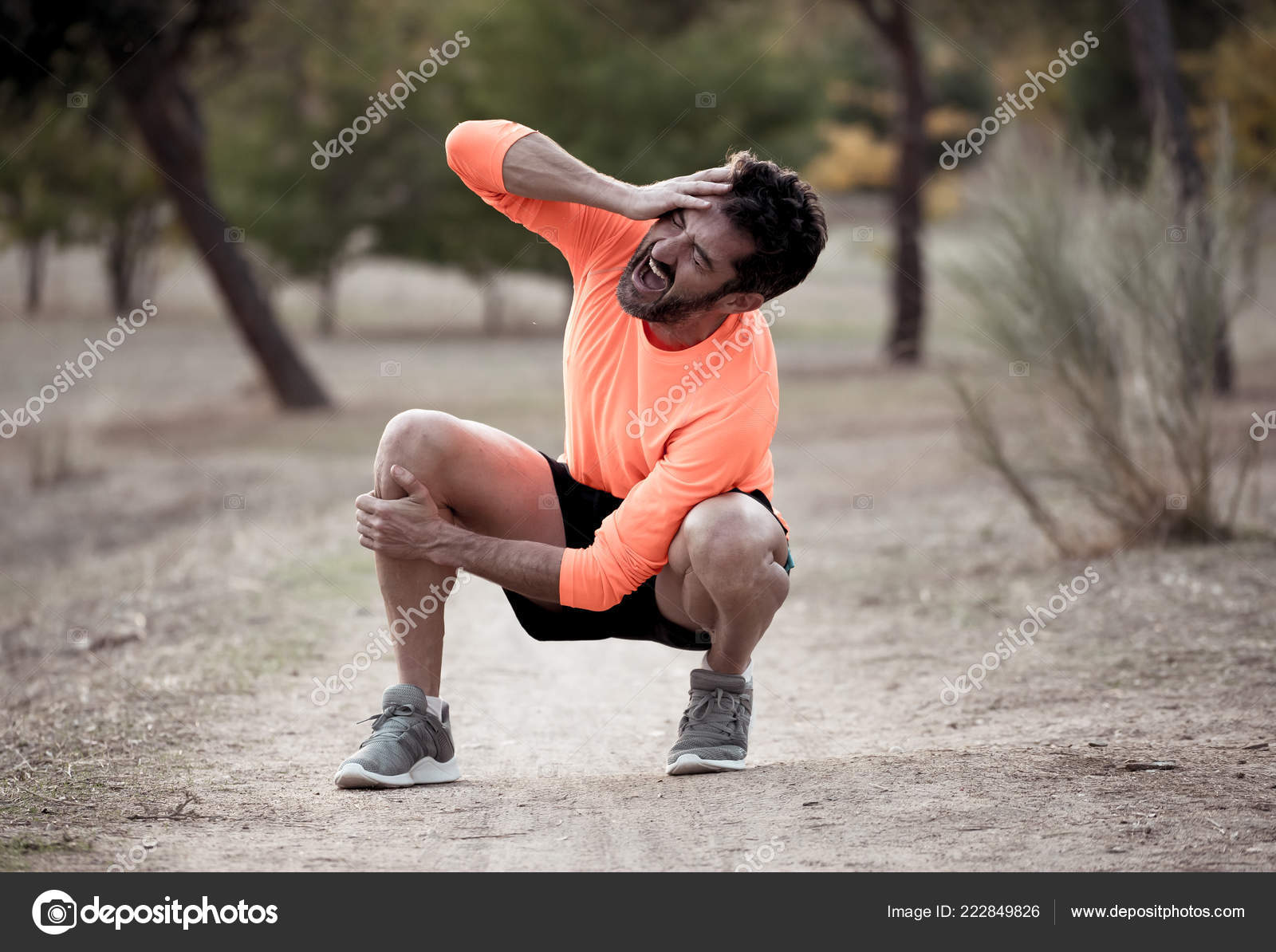 Young Fit Man Holding Knee His Hands Pain Suffering Muscle