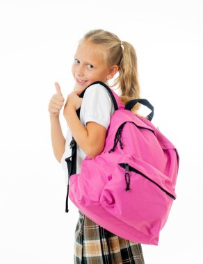 Pretty cute blonde hair girl with a pink schoolbag looking at camera showing thumb up gesture happy to go to school isolated on white background in back to school and children education concept.
