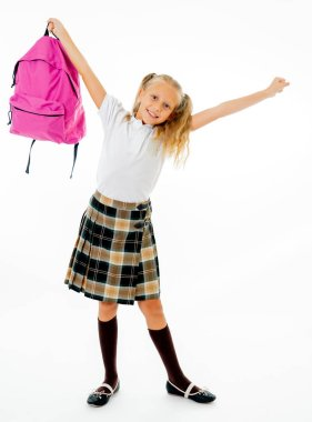 Adorable beautiful little schoolgirl with big pink schoolbag feeling excited and happy being back to school isolated on white background in end of the year and children education concept.