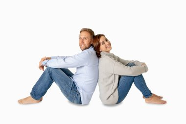 Happy couple isolated on white background with copy space Thinking and Planning wealthy future together in Love, Buying First house, having Child Baby and family financial well-being concept.