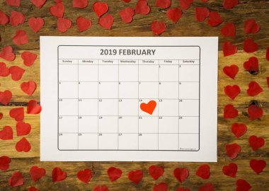 Conceptual image of 2019 february calendar and present gift wrapped with red ribbon on rustic vintage table in getting ready for saint Valentines day date, Love and romantic anniversary concept. stock vector