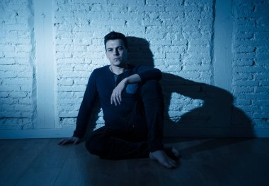 Portrait of sad depressed young man crying devastated feeling hurt suffering Depression in People, Sadness, Emotional pain, Loneliness and Heartbroken concept with copy space and dark mood light.