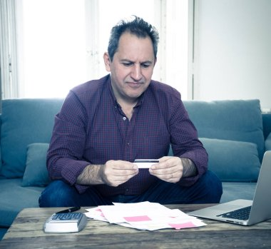 Upset mature man stressed about credit card debts and payments not happy accounting finances