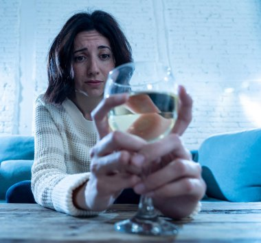 Portrait of sad, unhappy, helpless woman drinking wine. Human emotions, depression and alcoholism
