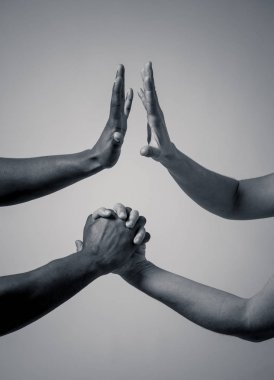 Black African American and Caucasian hands holding together. Conceptual image of Races coming together in world unity and stop racism. In racial tolerance understanding and cooperation concept