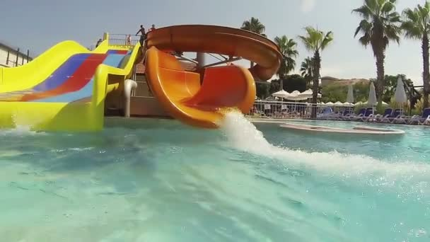 Man having fun on a water slide in a water park.